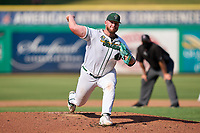 Tulane Green Wave pitcher Trent Johnson (42) delivers a pitch during a game against the Houston Cougars on May 25, 2021 at BayCare Ballpark in Clearwater, Florida.  Tulane defeated Houston 4-1 in the opening game of the American Athletic Conference Tournament.  (Mike Janes/Four Seam Images)