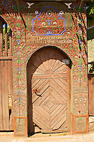 Traditional wooden Székely ( Szekely ) gates in a Szekely village near Cluj, Eastern Transylvania. Carved with folk art & painted the Szekely gate also has dove cotes above the gate.
