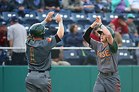 Steven Linkous (7) of the Boise Hawks is greeted by teammate J. B. Moss after hitting a home run against the Everett AquaSox at Everett Memorial Stadium on July 20, 2017 in Everett, Washington. Everett defeated Boise, 13-11. (Larry Goren/Four Seam Images)