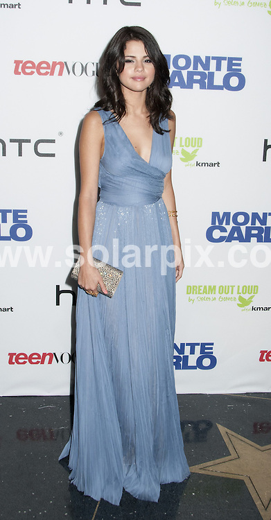 """**ALL ROUND PICTURES FROM SOLARPIX.COM**                                             **SYNDICATION RIGHTS FOR UK, AUSTRALIA, DENMARK, PORTUGAL, S. AFRICA, SPAIN & DUBAI (U.A.E) & ASIA (EXCLUDING JAPAN) ONLY**  .Caption:  """"Monte Carlo"""" New York City Premiere - Arrivals - AMC Loews Lincoln Square - New York City, NY, USA, on June 23, 2011                                                                               This pic: Selena Gomez                                                                                           JOB REF: 13606      PHZ Mayer       DATE: 23_06_2011                                                            **MUST CREDIT SOLARPIX.COM OR DOUBLE FEE WILL BE CHARGED**                                                                        **MUST NOTIFY SOLARPIX OF ONLINE USAGE**                 **CALL US ON: +34 952 811 768 or LOW RATE FROM UK 0844 617 7637**"""