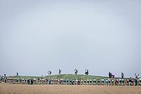 Peloton pedalling the cobbles on sector n°25. <br /> <br /> 116th Paris-Roubaix (1.UWT)<br /> 1 Day Race. Compiègne - Roubaix (257km)