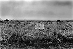 Jesus Saves, Born again Christian movement sign fixed to a fence enclosing barren land. Big Spring, Howard County, Texas 1999