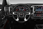 Steering wheel view of a 2014 GMC Sierra 1500 SLE Crew Cab