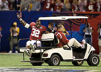 C.J. Mosley of Alabama waves to the fans after injured his leg during BCS National Championship game against LSU at Mercedes-Benz Superdome in New Orleans, Louisiana on January 9th, 2012.   Alabama defeated LSU, 21-0.