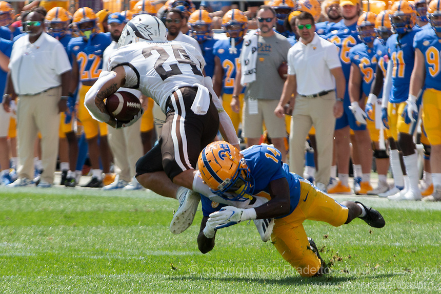Pitt defensive back Marquis Williams (14) tackles WMU wide receiver Skyy Moore (24). The Western Michigan University Broncos defeated the Pitt Panthers 44-41 at Heinz Field, Pittsburgh, Pennsylvania on September 18, 2021.