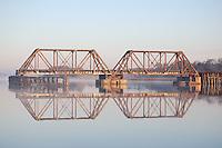 Old Railroad bridge on the intercoastal waterway near Appalatchacola Florida in the early morning
