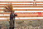 Indian man selling flutes on the ghats by the Ganges River in Varanasi, Uttar Pradesh, India