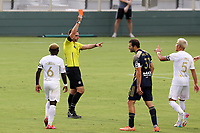 CARY, NC - AUGUST 01: Kevin Broadley issues a red card during a game between Birmingham Legion FC and North Carolina FC at Sahlen's Stadium at WakeMed Soccer Park on August 01, 2020 in Cary, North Carolina.