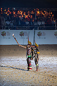 A Kuikuro Man and woman carry the Sacred Flame torch during the opening ceremony at the first ever International Indigenous Games, in the city of Palmas, Tocantins State, Brazil. Photo © Sue Cunningham, pictures@scphotographic.com 23rd October 2015