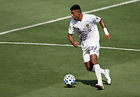 LOS ANGELES, CA - AUGUST 22: Julian Araujo #22 of the Los Angeles Galaxy moves with the ball during a game between Los Angeles Galaxy and Los Angeles FC at Banc of California Stadium on August 22, 2020 in Los Angeles, California.
