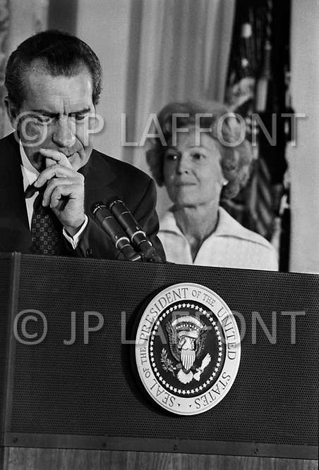 Washington, DC. August 9th,1974.<br /> President Richard Nixon (with his wife Pat on the right) resigned the presidency on August 9, 1974 saying farewell to his Cabinet and White House staff. A break in at the Democratic National Committee headquarters at the Watergate complex on June 17, 1972 results in one of the biggest political scandals the US government has ever seen.
