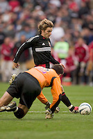 D.C. United's Bobby Convey is forced wide by San Jose Earthquakes' goal keeper Pat Onstad. DC United defeated the San Jose Earthquakes 2 to 1 during the MLS season opener at RFK Stadium, Washington, DC, on April 3, 2004.