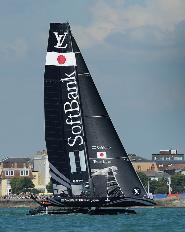 SoftBank Team Japan, JULY 23, 2016 - Sailing: SoftBank Team Japan races in front of the Southsea seafront during day one of the Louis Vuitton America's Cup World Series racing, Portsmouth, United Kingdom. (Photo by Rob Munro/Stewart Communications)