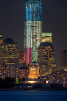 The Statue of Liberty and the Freedom Tower (One World Trade Center) in New York City represent two symbols of freedom on Tuesday, September 11, 2012 near the lights of the Tribute in Light , an annual memorial to the events of September 11, 2001.  The Freedom Tower, lighted in the red, white, and blue colors of the American flag, is under construction at the site of the original Twin Towers and is scheduled for completion in 2013.