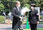 August 15, 2020, Tokyo, Japan - Japanese Chief Cabinet Secretary Yoshihide Suga holds a flower bouquet to offer for war victims at the Chitorigafuchi National Cemetery in Tokyo on Saturday, August 15, 2020. Japan marked the 75th anniversary of its surrender of World War II.        (Photo by Yoshio Tsunoda/AFLO)