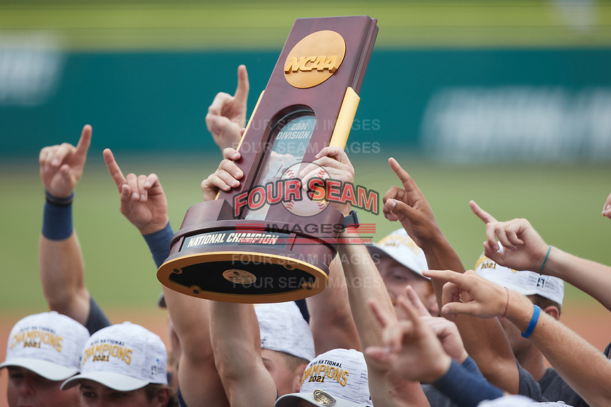 The Wingate Bulldogs hold their National Champion trophy in the air following their win over the Central Missouri Mules the 2021 DII Baseball National Championship at Coleman Field at the USA Baseball National Training Complex on June 12, 2021 in Cary, North Carolina. The Bulldogs defeated the Mules 5-3. (Brian Westerholt/Four Seam Images)