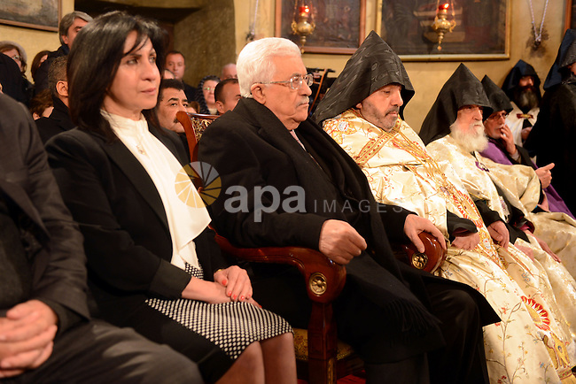 Palestinian President, Mahmoud Abbas (Abu Mazen), attends a celebration  Christmas to mark the birth of Jesus on January 18, according to the Julian calendar in the West Bank city of Bethlehem on January 18, 2015. Photo by Thaer Ganaim
