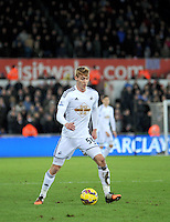 SWANSEA, WALES - JANUARY 17:   of  during the Barclays Premier League match between Swansea City and Chelsea at Liberty Stadium on January 17, 2015 in Swansea, Wales. Swansea's Jay Fulton on the ball