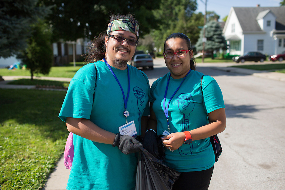"""Ryan Ocampo, left, and Natalie Henriquez pose for a photo as they pick up trash in the Hawthorne neighborhood during """"Circle the City with Service,"""" the Kiwanis Circle K International's 2015 Large Scale Service Project, on Wednesday, June 24, 2015, in Indianapolis. (Photo by James Brosher)"""