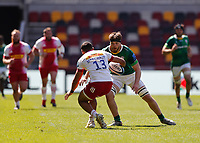 24th April 2021; Brentford Community Stadium, London, England; Gallagher Premiership Rugby, London Irish versus Harlequins; Ben Donnell of London Irish covers the run from Joe Marchant of Harlequins