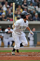 Left fielder Kevin Kaczmarski (10) of the Columbia Fireflies hits the team's first RBI in the home opener against the Greenville Drive on Thursday, April 14, 2016, the team's first day at the new Spirit Communications Park in Columbia, South Carolina. The Mets affiliate moved to Columbia this year from Savannah. Columbia won, 4-1. (Tom Priddy/Four Seam Images)