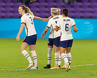 ORLANDO, FL - JANUARY 22: Megan Rapinoe #15 celebrates her goal with Emily Sonnett #14 and teammates during a game between Colombia and USWNT at Exploria stadium on January 22, 2021 in Orlando, Florida.