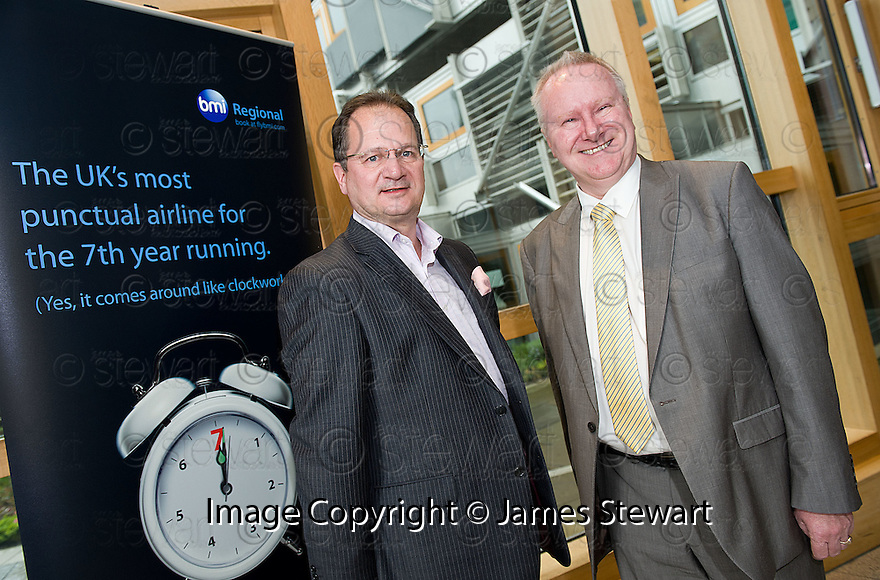 Cabinet Secretary for Infrastructure and Capital Investment, Alex Neil MSP (right),  with Graeme Ross, Business Development Director, BMI Regional, at the announcement of the sale of BMI Regional's sale from IAG to Sector Aviation  Holdings (SAH) .............31/05/2012    jsp002_bmi   .Copyright  Pic : James Stewart.James Stewart Photography 19 Carronlea Drive, Falkirk. FK2 8DN      Vat Reg No. 607 6932 25.Telephone      : +44 (0)1324 570291 .Mobile              : +44 (0)7721 416997.E-mail  :  jim@jspa.co.uk.If you require further information then contact Jim Stewart on any of the numbers above........