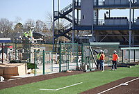 A construction crew works, Monday, November 16, 2020 at Rogers Heritage in Rogers. Nabholz construction is completing construction on Heritage's new baseball and softball fields as well as an auxiliary gym, which are both scheduled to be complete before Christmas. The ball fields, an $11.6 million project, are modeled after the Naturals's ball field with stadium seating, synthetic turf, a digital display board and a bleacher structure that allows players to access the locker room from the dugout said Darrell Newtown, project superintendent. Check out nwaonline.com/201117Daily/ for today's photo gallery. <br /> (NWA Democrat-Gazette/Charlie Kaijo)