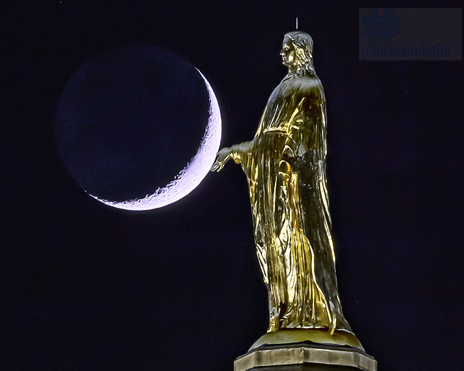 June 13, 2021; Mary statue on the Golden Dome with crescent moon (Photo by Matt Cashore/University of Notre Dame)