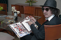 """Venezuela: Caracas,13/06/13 <br /> Argentine rock star Charly Garcia, poses in his room at the Hotel Eurobuilding in Caracas, while showing a notebook with sketches and ideas for the suite """"Parallel Lines"""" which will premiere on September 23 at the Teatro Colon, Buenos Aires , Argentina. Garcia was in Caracas, accompanied by his band The Prostitution, giving a couple of concerts of his tour The Unknown Dimension.<br /> Carlos Hernandez/Archivolatino"""