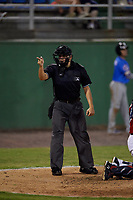 Umpire Josh Gilreath calls a strike during a Carolina League game between the Myrtle Beach Pelicans and Potomac Nationals on August 14, 2019 at Northwest Federal Field at Pfitzner Stadium in Woodbridge, Virginia.  Potomac defeated Myrtle Beach 7-0.  (Mike Janes/Four Seam Images)