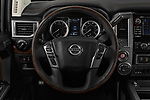 Car pictures of steering wheel view of a 2018 Nissan Titan Platinum-Reserve-Crew 4 Door Pickup Steering Wheel
