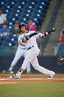 Tampa Tarpons third baseman Angel Aguilar (7) follows through on a swing during a game against the Daytona Tortugas on April 18, 2018 at George M. Steinbrenner Field in Tampa, Florida.  Tampa defeated Daytona 12-0.  (Mike Janes/Four Seam Images)