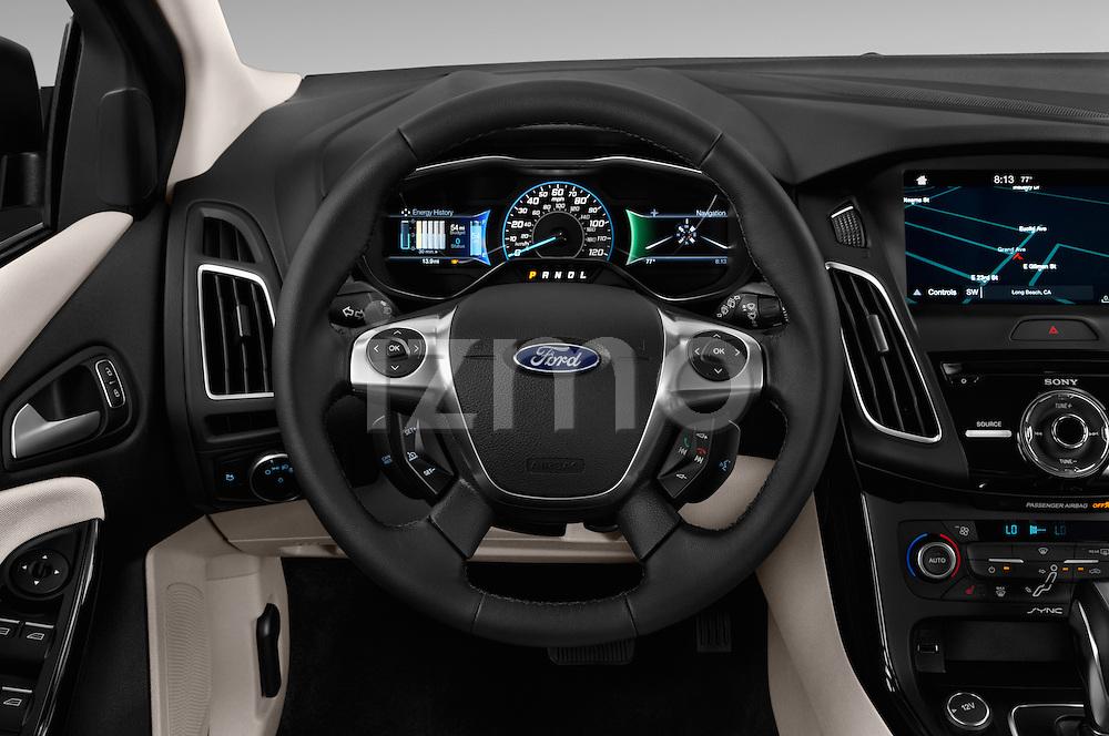 Car pictures of steering wheel view of a 2016 Ford Focus 5-Door-Hatch-Electric 5 Door Hatchback Steering Wheel