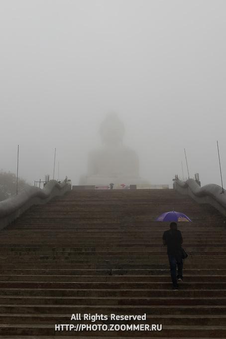 Stairs to the Big Buddha monumet during rain on Phuket, Thailand
