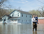 Father holding son standing in flooded street
