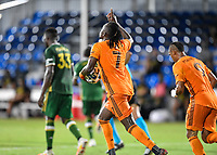 LAKE BUENA VISTA, FL - JULY 18: Alberth Elis #7 of the Houston Dynamo celebrate his goal on a penalty kick and carries the ball back to midfield during a game between Houston Dynamo and Portland Timbers at ESPN Wide World of Sports on July 18, 2020 in Lake Buena Vista, Florida.