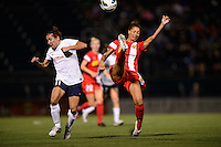 Western New York Flash defender Estelle Johnson (12) plays the ball away from Sky Blue FC forward Lisa De Vanna (11). The Western New York Flash defeated Sky Blue FC 2-0 during a National Women's Soccer League (NWSL) semifinal match at Sahlen's Stadium in Rochester, NY, on August 24, 2013.