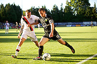 Manchester City's Craig Bellamy and Portland Timbers' Ian Joy during a match at Merlo Field in Portland Oregon on July 17, 2010.