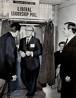 1968 FILE PHOTO - ARCHIVES -<br /> <br /> His choice recorded, Quebec's Eric Kierans, a candidate for the Liberal leadership, steps from thhe Toronto  Star voting machine set up at York-Scarborough Liberal Association's conference today. Waiting to vote (right) is MP Robert Stanbury<br /> <br /> 1968<br /> <br /> PHOTO : Boris Spremo - Toronto Star Archives - AQP