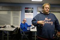 Volunteers make calls to gather support for former senator Rick Santorum at Santorum's New Hampshire campaign headquarters in Bedford, New Hampshire, on Jan. 7, 2012.  Santorum is seeking the 2012 Republican presidential nomination.