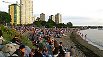 2008 HSBC Celebration of Light.Throngs of spectators line the beach on English Bay in the city of Vancouver, B.C., Canada, in anticipation of the ten o'clock fireworks show presented by the Chinese team from Hong Kong, Pyromagic Productions Ltd. It was estimated that by the time of the show over 200,000 people lined the beach and sidewalks..Since 1990, Vancouver has been home to the Celebration of Light (originally known as the Symphony of Fire).  This international pyro-musical fireworks competition has attracted the world's leading fireworks designers and is seen as a highly prestigious event.  The fireworks festival creates an exciting arena where spectators can enjoy each country's representatives unveil their latest techniques and use the most innovative fireworks materials as they compete  to be crowned the winner.