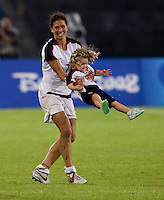 USWNT midfielder (7) Shannon Boxx spins Rylie Rampone after playing at Worker's Stadium.  The USWNT defeated Japan, 4-2, during the semi-finals of the Beijing 2008 Olympics in Beijing, China.