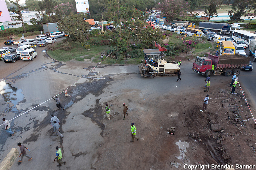 Traffic is stopped at Museum Hill roundabout as Chinese contractors unload heavy equipment.