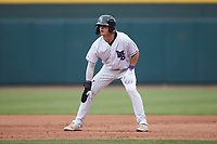 Travis Maniot (14) of the Winston-Salem Dash takes his lead off of first base against the Greensboro Grasshoppers at Truist Stadium on June 19, 2021 in Winston-Salem, North Carolina. (Brian Westerholt/Four Seam Images)