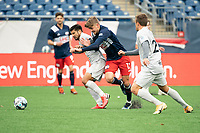 FOXBOROUGH, MA - APRIL 17: Zaca Moran #6 of Richmond Kickers and Justin Rennicks #12 of New England Revolution II battle for the ball during a game between Richmond Kickers and Revolution II at Gillette Stadium on April 17, 2021 in Foxborough, Massachusetts.