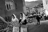 A young girls are walking down the streets during the celebration of the wedding ceremony in the village of Ribnovo, some 200 km from Sofia, Bulgaria.