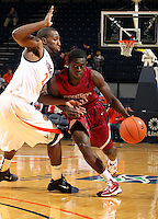 Nov 6, 2010; Charlottesville, VA, USA; Roanoke College g Kwasi Amponsah (11) drives past Virginia Cavaliers g KT Harrell (24) Saturday afternoon in exhibition action at John Paul Jones Arena. The Virginia men's basketball team recorded an 82-50 victory over Roanoke College.