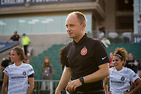 CARY, NC - SEPTEMBER 12: Portland Thorns head coach Mark Parsons visits with players after a game between Portland Thorns FC and North Carolina Courage at WakeMed Soccer Park on September 12, 2021 in Cary, North Carolina.