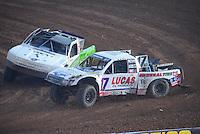 Dec. 11, 2011; Chandler, AZ, USA;  LOORRS pro 2 driver Carl Renezeder leads Jeff Geiser during the Lucas Oil Challenge Cup at Firebird International Raceway. Mandatory Credit: Mark J. Rebilas-